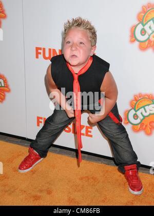 Oct. 25, 2012 - Los Angeles, California, U.S. - Actor JACKSON NICOLL flexes at the Los Angeles Premiere of 'Fun - Stock Photo