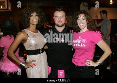 Cheaza Figueroa, Junior (Bartender), Stephanie Kirby (Director of Susan G. Komen Southern Nevada Affiliate) at arrivals - Stock Photo