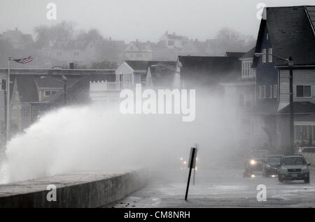 Winthrop, Massachusetts, USA. Waves driven by high winds from Hurricane Sandy crash over the seawall in Winthrop, - Stock Photo