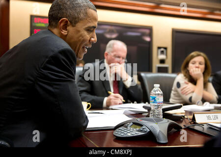 President Barack Obama participates in a conference call with electric utility executives to discuss the restoration - Stock Photo