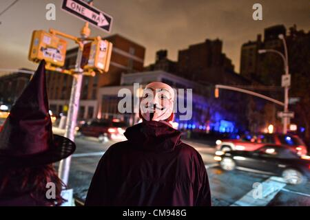 After Hurricane Sandy, in pitch dark downtown, New Yorkers experience one of the darkest Halloween nights ever. - Stock Photo