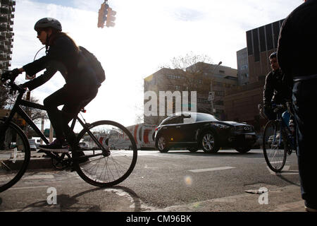 November 1st, 2012, New York, NY, USA : Many New Yorkers are getting around the city on bikes after hurricane Sandy - Stock Photo