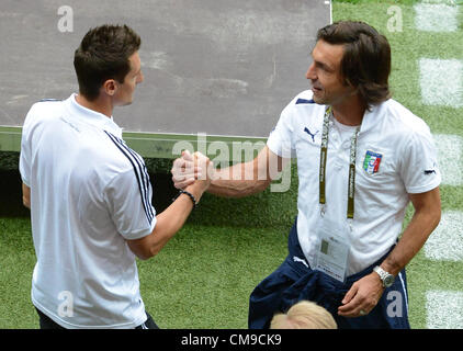 28.06.2012 Warsaw, Poland.  Germany's Miroslav Klose (L) shakes hands with Italy's Andrea Pirlo prior to the UEFA - Stock Photo
