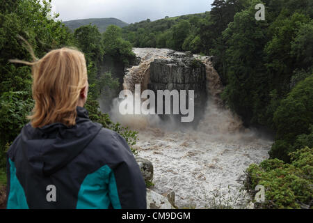 Woman Enjoying the Spectacle of High Force Waterfall on the River Tees, Teesdale, UK on the 28 June, 2012.  After - Stock Photo
