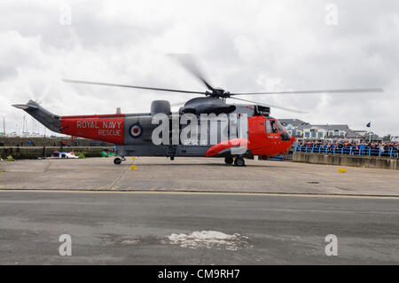 Carrickfergus, 30/06/2012 - Armed Forces Day. Royal Navy Sea King helicopter  Rescue 177 lands - Stock Photo