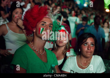 Italy's football fans watch the match on the giant screen at the Circo Massimo in Rome. - Stock Photo