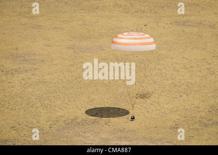 The Soyuz TMA-03M spacecraft is seen touching down as it lands with Expedition 31 Commander Oleg Kononenko of Russia - Stock Photo