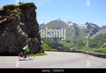05.06.2012. Pyrenees Mountains, France.  A cyclist riding down Col d'Aubisque in the Pyrenees. Winter sport resort - Stock Photo