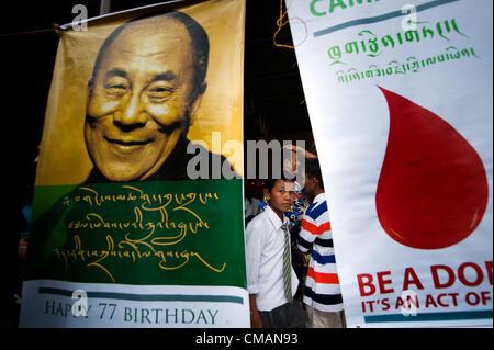 July 6, 2012 - Kathmandu, Kathmandu, Nepal - A boy passes by the poster of his holiness' Dalai Lama displayed at - Stock Photo