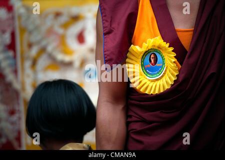July 6, 2012 - Kathmandu, Kathmandu, Nepal - A Buddhist monk wares guest badge with Dalai Lama's portrait during - Stock Photo