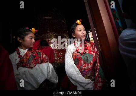 July 6, 2012 - Kathmandu, Kathmandu, Nepal - A Tibetan refugee girls dressed in traditional Tibetan costume attend - Stock Photo