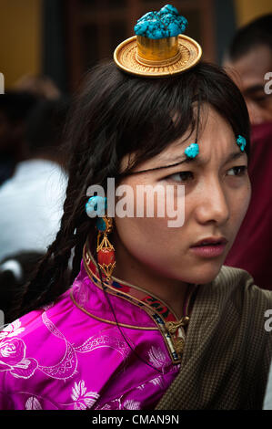 July 6, 2012 - Kathmandu, Kathmandu, Nepal - A Tibetan refugee girl dressed in traditional Tibetan costume attends - Stock Photo