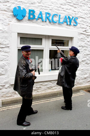 David & Brian Nicholson re-enactors of the WWii French Resistance outside Barclays Bank in the village of Ingleton - Stock Photo