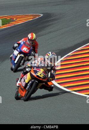 08.07.2012. Hohenstein-Ernstthal, Germany. German rider Sandro Cortese of Team Red Bull KTM leads the Moto3 race - Stock Photo