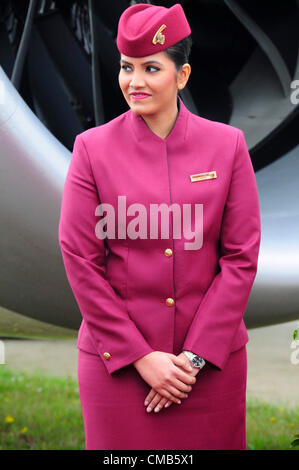 Farnborough, UK. Monday 9th July 2012.  Air stewardess welcoming guests to view the Qatar Airlines Boeing 787 'Dreamliner' - Stock Photo
