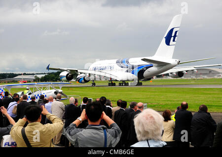 Farnborough International Airshow, UK,  2012.  Monday 9 July 2012, Farnborough,  crowds watch the giant Malaysia - Stock Photo