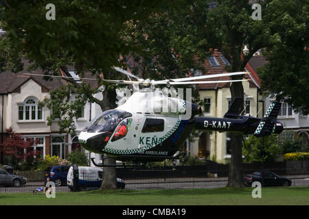London 10/7/12. G-KAAT, a McDonnell Douglas MD-902 EXPLORER helicopter of the Kent Air Ambulance takes off over - Stock Photo