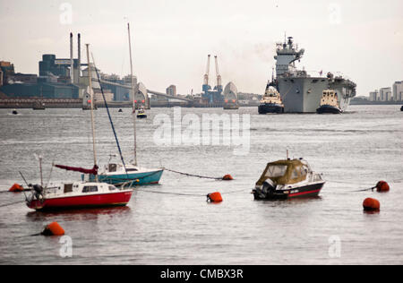 London, UK - 13 July 2012: Royal Navy's biggest ship HMS Ocean sails up Thames towards Greenwich where it will be - Stock Photo