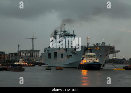 London, UK. 13th July 2012 HMS Ocean, the largest in the Navy, sailed up the Thames, past the Thames barriers, up - Stock Photo