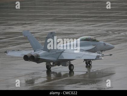 Farnborough, UK. 13 July, 2012. An F-18 Super Hornet jet fighter waits to take off in the rain Farnborough International - Stock Photo