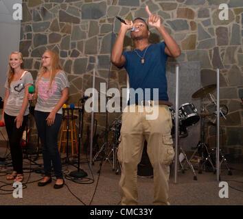 Riverdale Park, Md USA July13, 2012... Benefit Concert...  Gospel Rapper Phresh Air teams with gospel singers Anna - Stock Photo