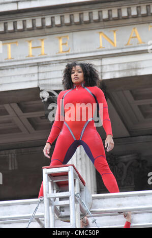 London, UK. 15th July 2012. A performer stands on top of the spinning ladder. One Extraordinary Day, Surprises: - Stock Photo