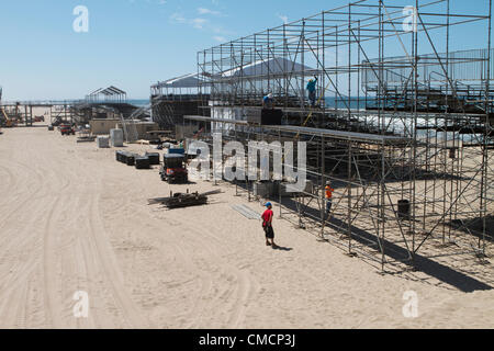 July 19th 2012  Construction crews work on erecting the stands, stadiums ,seating and bleachers south of Huntington - Stock Photo