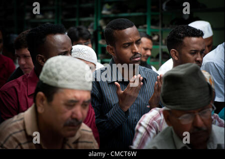 July 20, 2012 - Kathmandu, Nepal - A Somali refugee (centre) prays during Friday prayers in the Jame mosque marking - Stock Photo