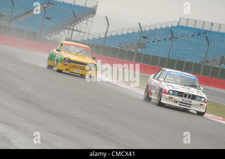 20th July 2012, Silverstone, UK  David Cuff and Mark Smith's BMW E30 M3, and Michael Bell's Ford Escort in the rain - Stock Photo