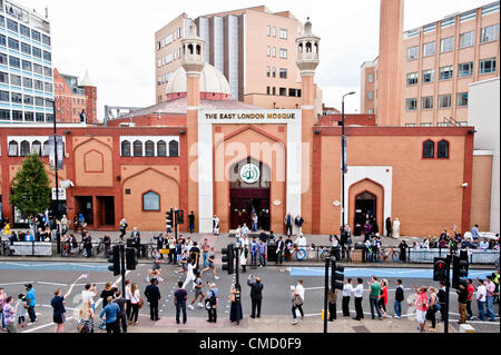 London, UK - 21 July 2012: the Olympic Torch passes in front of the East London Mosque in Whietchapel on the second - Stock Photo