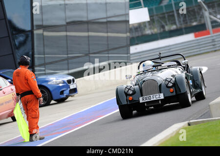 21st July 2012, Silverstone, UK.  AC/DC frontman Brian Johnson drives into the pit lane after completing qualifying - Stock Photo