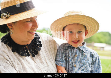 Old Bethpage, New York, USA - July 21, 2012: MICHELE WALKER of Coram and her son ROBERT WALKER, 4, wear clothes - Stock Photo