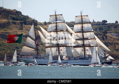 The Sagres tall ship sails on the River Tagus as it departs Lisbon, Portugal. It is one of the vessels taking part - Stock Photo