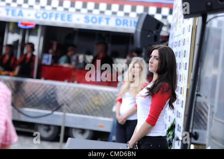 21st July 2012, Silverstone, UK.  Two girls wait on the podium after the Silverstone Classic Celebrity Race - Stock Photo