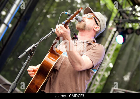 Rock star / musician John McCrea of the alt rock  indie rock  indy rock band Cake | Performing / playing guitar - Stock Photo
