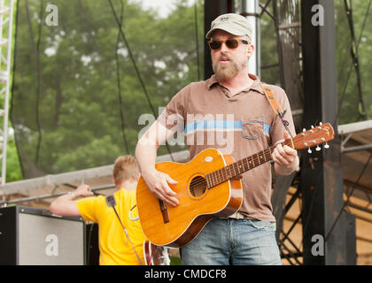 Rock star / musician John McCrea of the alt rock  indie rock  indy rock band Cake   Performing / playing guitar - Stock Photo