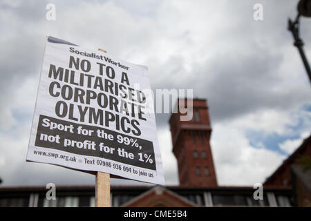 London, UK. 28th July 2012 The anti Olympic march passes by the site of Fred Wigg Tower in Bow where anti aircraft - Stock Photo