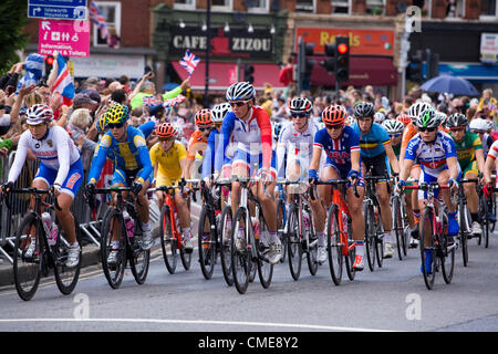Front riders in the Women's Road Race Final pass through Twickenham in West London, UK, on Sunday July 29th. London - Stock Photo