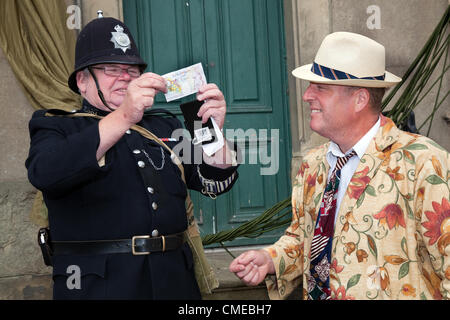 Tim Handley of Grantham as Max Miller comedian in Floral Suit  'Paying Police' The market place Leyburn   One of - Stock Photo