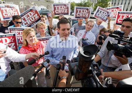 Tea Party US Senate candidate Ted Cruz greets supporters and the press outside a polling place in Houston July 31, - Stock Photo