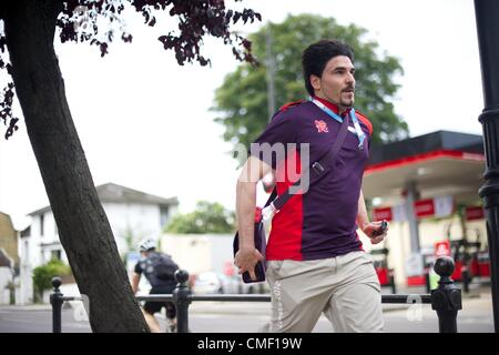 Aug. 1, 2012 - London, England, United Kingdom - An Olympic employee races to catch a train to the Olympic Park - Stock Photo