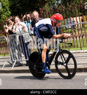 Bradley Wiggins manages a smile on his way to gold medal in the men's time trial. Here he is shown leaving Twickenham, - Stock Photo