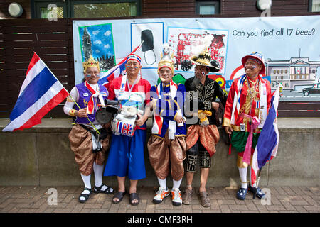 Excel, London, UK. Wednesday 1st August 2012. Spectators from Thailand in costume at London Olympic Games 2012. - Stock Photo