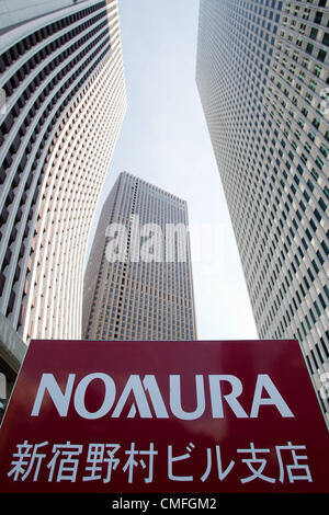 August 3, 2012 - Tokyo, Japan - The Shinjuku building of Nomura Holdings Inc. (right) is seen in downtown Tokyo. - Stock Photo