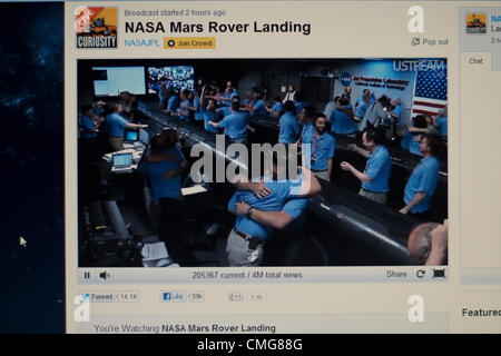 August 6th 2012. USA. Live Stream of NASA Mars Rover Landing. A computer screen view of NASA Engineers celebrating - Stock Photo
