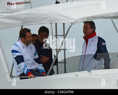 7th Aug 2012. Olympic Sailing, Prime Minister David Cameron visits London 2012 Olympic Games at the Weymouth & Portland Venue, Dorset, Britain, UK.  Seen here watching the RS:X with Gold medal winner in the Finn class Ben Ainslie August 7th, 2012 PICTURE: DORSET MEDIA SERVICE