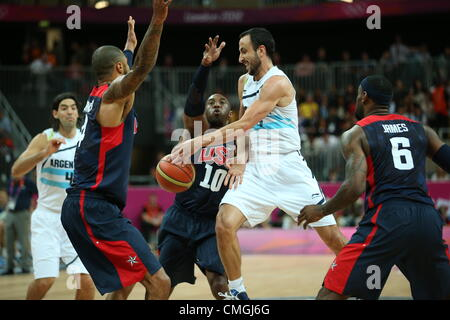 6th Aug 2012. 06.08.2012. London England. Manu Ginobili of Argentina (2nd R) fights for the ball with LeBron James - Stock Photo