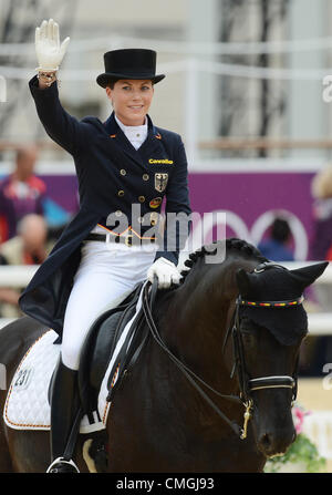 7th Aug 2012. 07.08.2012. London, England. Germany's dressage rider Kristina Sprehe cheers after perfoming with - Stock Photo
