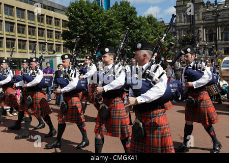 Members of the Strathclyde Police Pipe Band marching at the Piping Live Event in George Square, Glasgow, Scotland, - Stock Photo