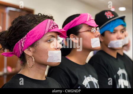 AUGUST 6, 2012 - Mineola, New York, U.S. - At Nassau County Legislature meeting, protesters from Strong Youth Inc - Stock Photo